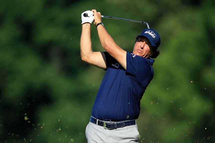 Phil Mickelson hits his second shot on the 13th hole during the first round of the FedEx St Jude Classic in Tennessee on June 7, 2018.
