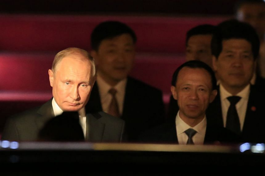Putin (left) arriving at Qingdao Liuting International Airport for a state visit to China on June 8, 2018.