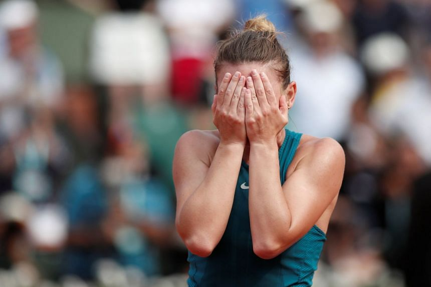 Halep celebrates after winning the final against Sloane Stephens.