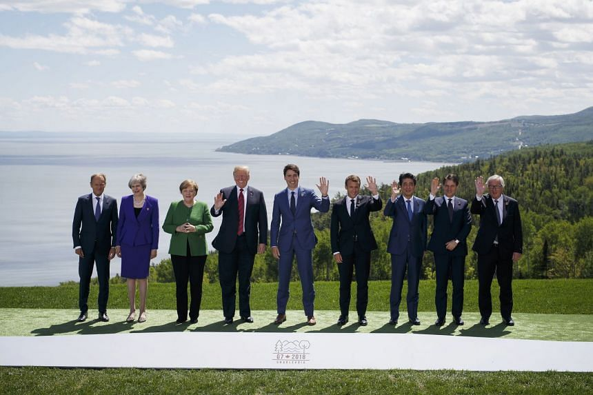 (From left) Donald Tusk, Theresa May, Angela Merkel, Donald Trump, Justin Trudeau, Emmanuel Macron, Shinzo Abe, Giuseppe Conte and Jean-Claude Juncker stand for a family photo.