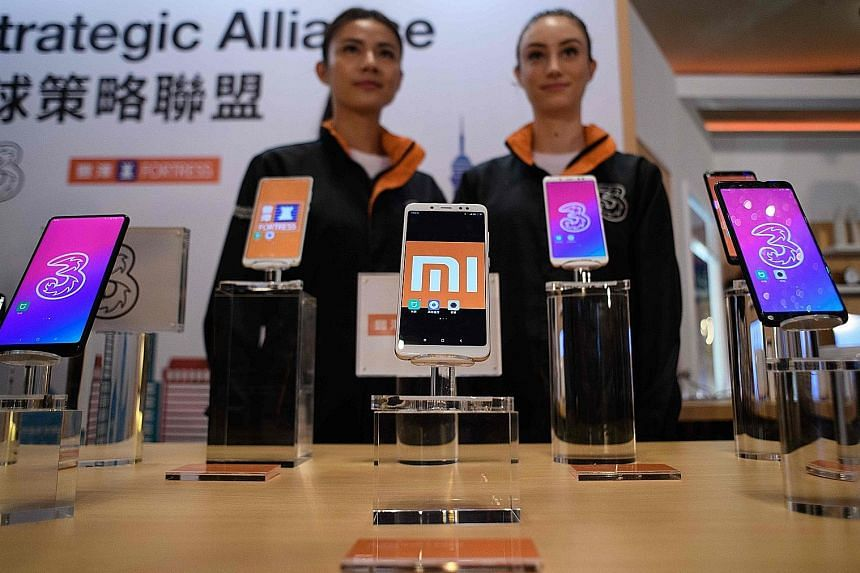 Xiaomi's smartphones on display in Hong Kong. The Beijing-based firm is said to be seeking about US$10 billion (S$13.4 billion) from its IPO. It was the first to file for a Hong Kong IPO with a weighted-voting rights structure after the city's bourse