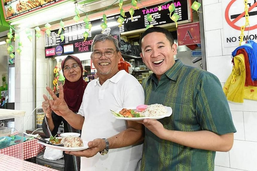 Muslims breaking fast at Geylang Serai can try Malay dishes like mee rebus, nasi sambal goreng and nasi ayam prepared using wholegrain ingredients. Senior Parliamentary Secretary for Health and Home Affairs Amrin Amin (in green) with stall owner Noor