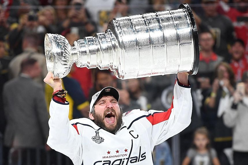 Russian forward Alex Ovechkin hoisting the Stanley Cup after the Washington Capitals beat the Vegas Golden Knights 4-3 in Game 5 of the Stanley Cup Finals at T-Mobile Arena in Las Vegas.