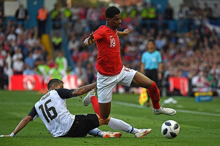 Marcus Rashford hurdling over Costa Rica's Cristian Gamboa in England's 2-0 win. Rashford is one of Gareth Southgate's five forwards and offers the England boss a different option to main striker Harry Kane.