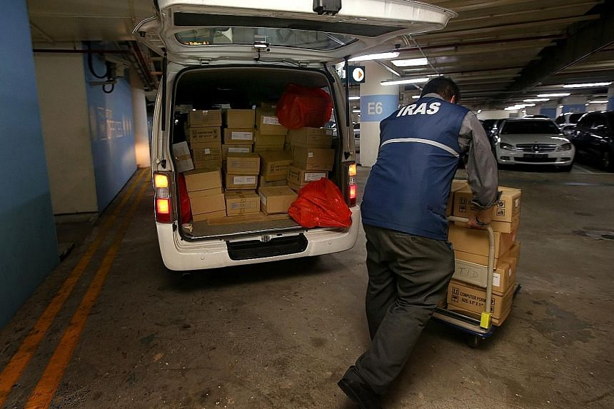 Iras forensic officers unloading documents and other evidence from a van at Revenue House after a raid on a firm.