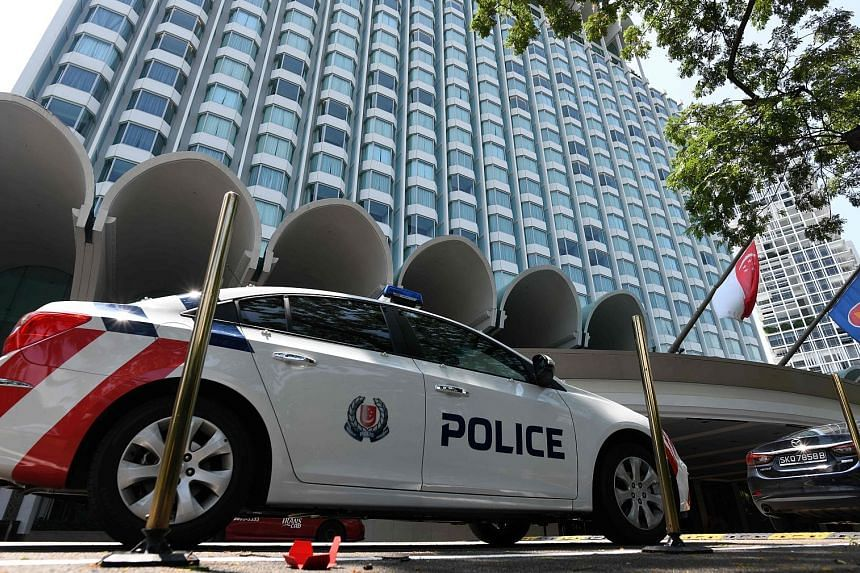 """Police presence yesterday at Shangri-La Hotel, where US President Donald Trump will reportedly stay during the summit. Local security forces have been """"working around the clock"""" to ensure a successful summit, said Mr K. Shanmugam."""