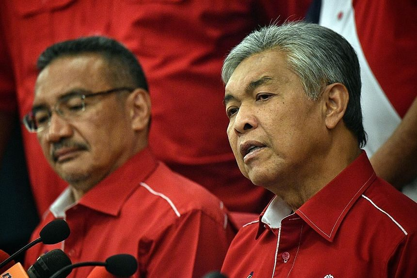 Mr Hishammuddin Hussein (left) says he wants to focus on rebuilding Umno as a member, while former deputy prime minister Ahmad Zahid Hamidi (right) has said he wants to step up as the next party president.
