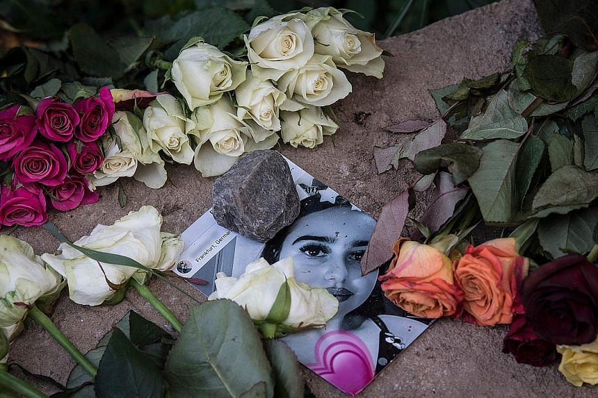 A picture of Susanna Maria Feldman at a makeshift memorial at the place where the 14-year-old girl was allegedly raped and murdered by failed Iraqi asylum seeker Ali Bashar in western Germany. His arrest in Iraq came after outrage in Germany as polic