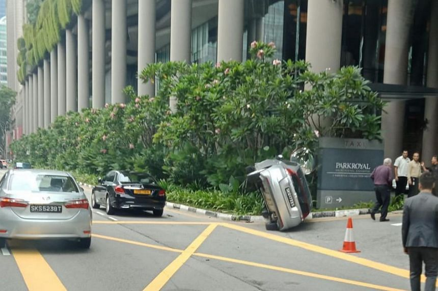 Photos posted on social messaging platform Telegram showed a silver car tipped onto its right, by the entrance of Parkroyal hotel.