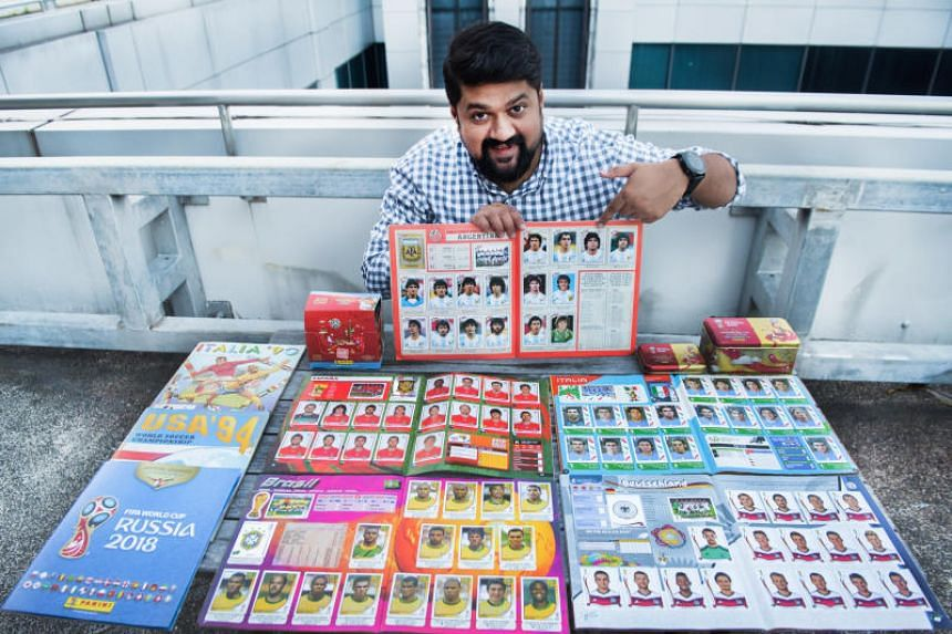 Mr Navin Nambiar holding on to the completed Argentina 1986 World Cup team sticker collection.