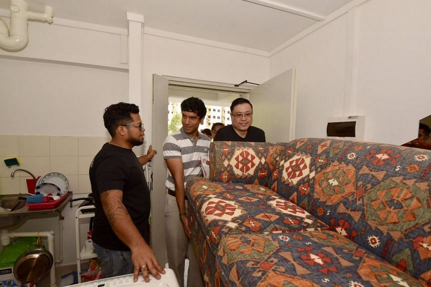 MP for Sembawang GRC Vikram Nair helps to carry a couch into Mr Feddlyshah bin Ibrahim's home, as part of the  Admiralty Furniture Donation & Distribution Drive.