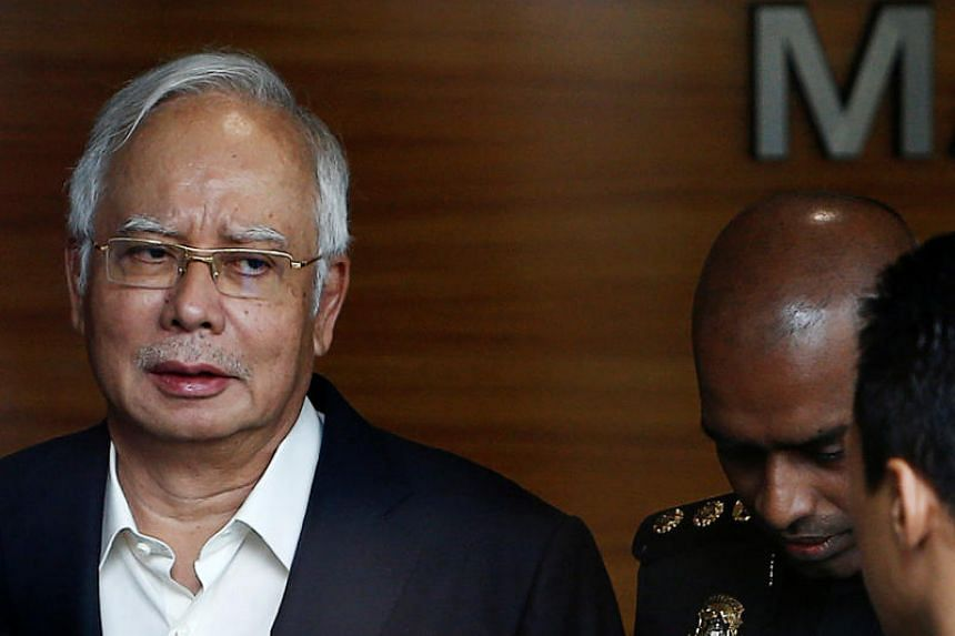 Malaysia's former prime minister Najib Razak arrives to give a statement to the Malaysian Anti-Corruption Commission (MACC), on May 24, 2018.