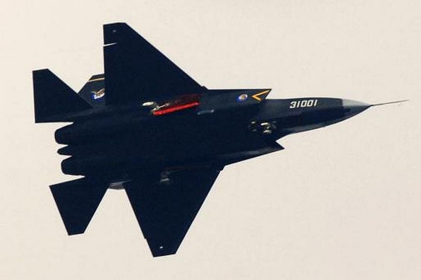 China's Shenyang J-31 stealth fighter (left) in a test flight. An F-35 stealth fighter (right) in action. Reports prepared for the Pentagon say that over the years, the Chinese have stolen designs for the F-35 joint strike fighter and the advanced Pa