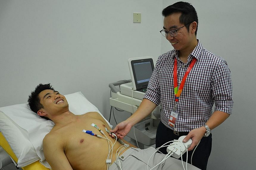 Dr Yeo Tee Joo performing an ECG test on marathoner Mok Ying Ren as part of the Sports Cardiology Registry project.