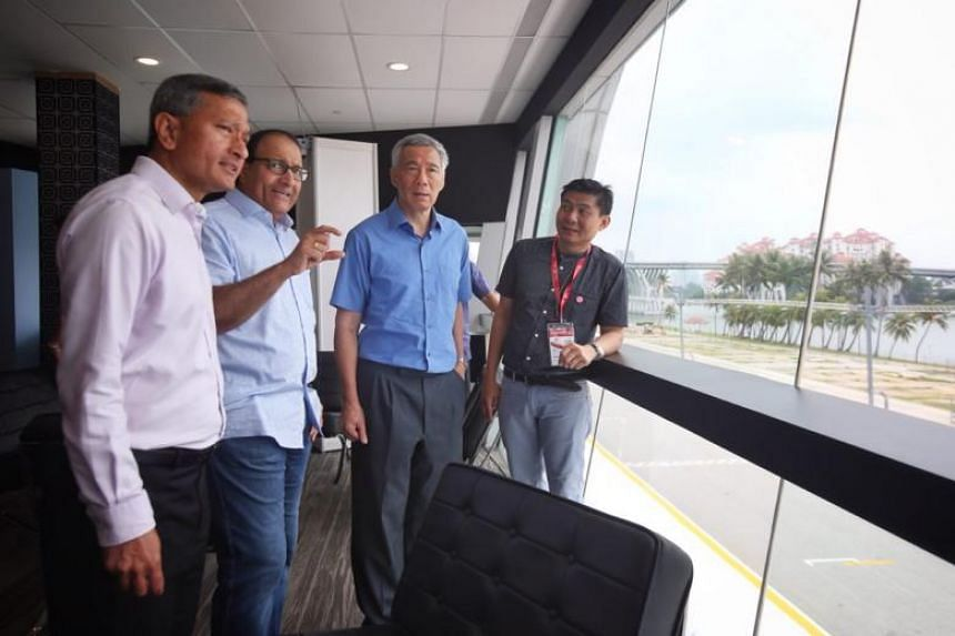Prime Minister Lee Hsien Loong (second right) visited the international media centre at the F1 Pit Building on June 10, 2018. He said the bill for hosting the historic Trump-Kim summit will come up to about $20 million.