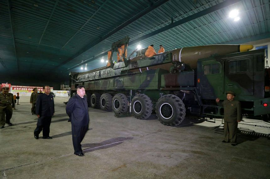 An undated file photo released on July 5, 2017, showing North Korean leader Kim Jong Un inspecting an intercontinental ballistic missile in Pyongyang.