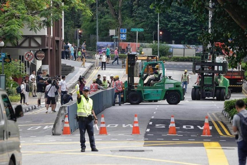 A police officer diverting traffic along Tomlinson Road towards Cuscaden Road on June 9, ahead of the summit on June 12.