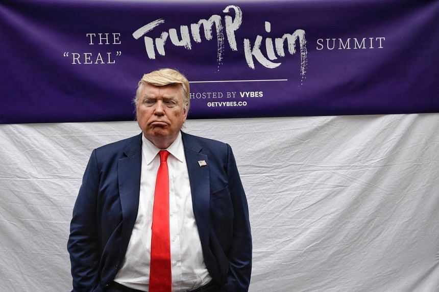 The Donald Trump impersonator, Dennis Alan, came clad in a navy suit and a red tie with an American flag pin.