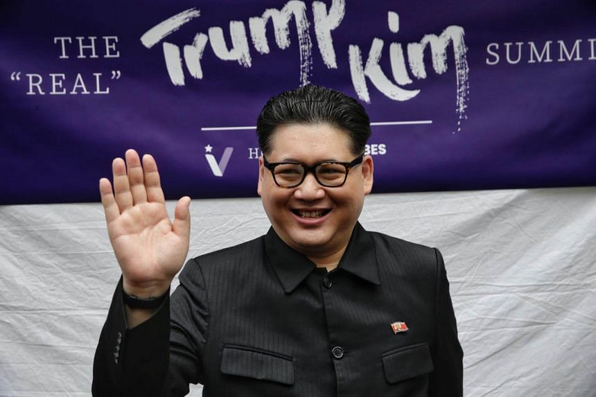 Decked in a black Mao-style suit with a North Korean flag pin and thick-rimmed glasses, the Hong Kong-based Kim impersonator, known as Howard X, did not miss a beat with his performance which came complete with the North Korean leader's signature han