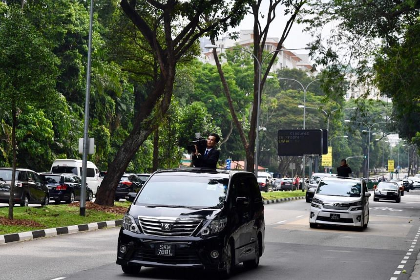 The North Korean motorcade going past Stevens Road on the way to the St Regis Hotel, on June 10, 2018.