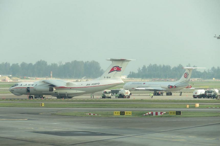 North Korean planes are seen on the tarmac in Changi Airport on June 10, 2018.