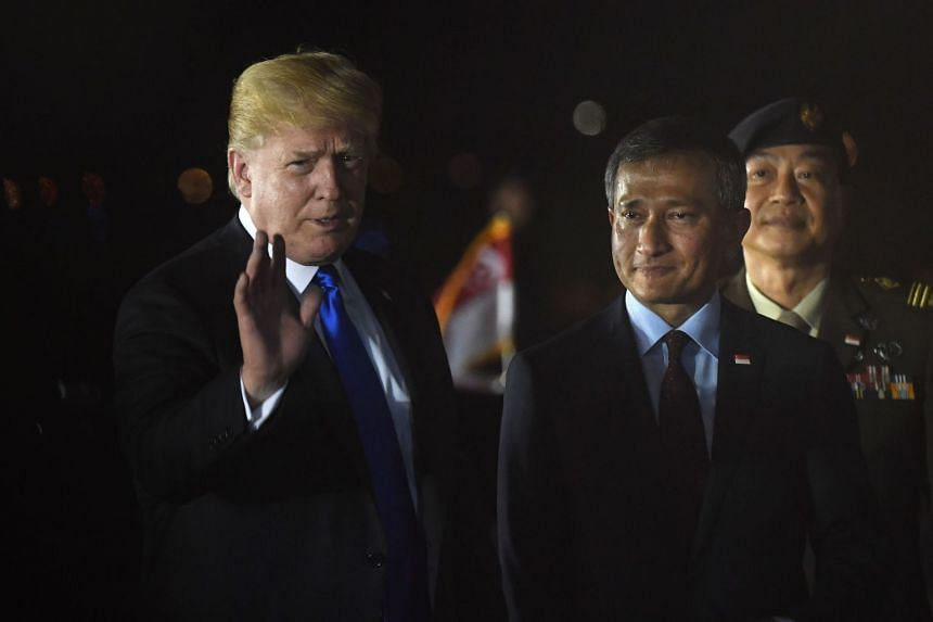 US President Donald Trump was welcomed by Foreign Minister Vivian Balakrishnan after arriving at Paya Lebar Airbase on June 10, 2018.