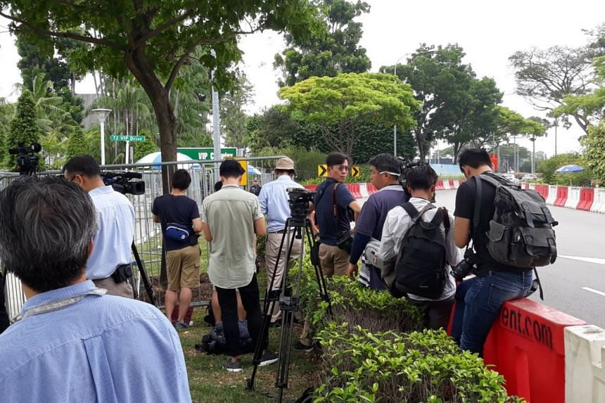 Journalists outside Changi Airport's VIP Complex waiting for North Korean leader Kim Jong Un.
