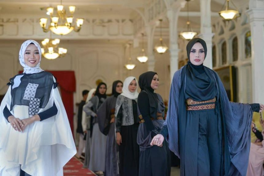 Acehnese models presenting Islamic fashion creations during the Indonesian Fashion Show in Banda Aceh on April 5, 2018.