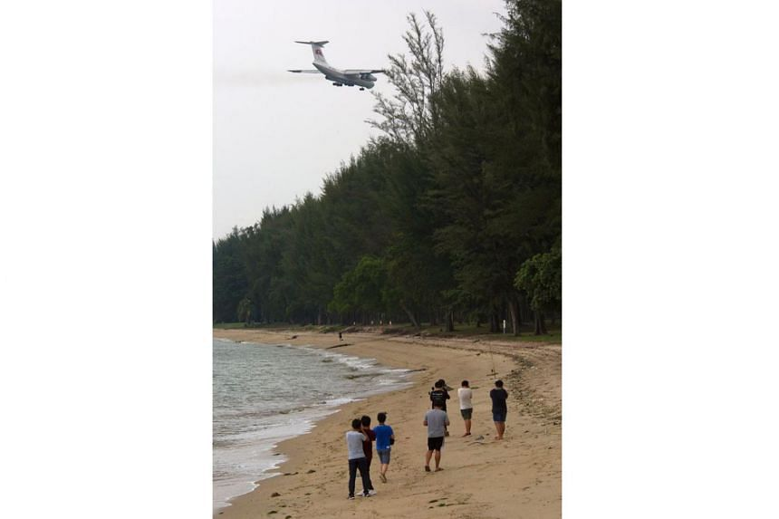 Aviation enthusiasts on Changi Beach taking photos of a North Korean plane landing at Changi Airport on June 10, 2018.