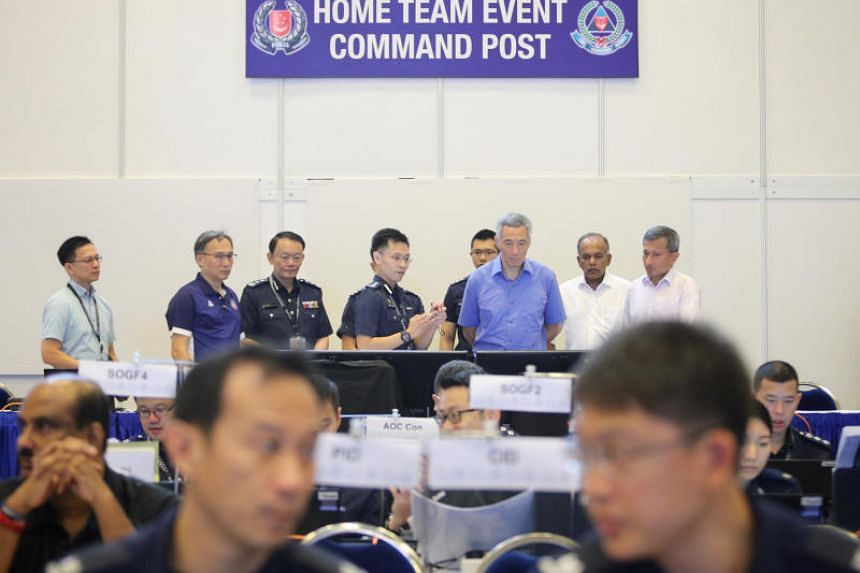 Prime Minister Lee Hsien Loong observing operations at the Home Team Command Post, alongside Home Affairs and Law Minister K. Shanmugam (second from right) and Foreign Minister Vivian Balakrishnan (extreme right).