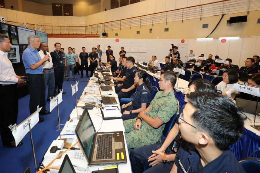 Prime Minister Lee Hsien Loong speaking to officers at the Home Team Command Post, on June 10, 2018.