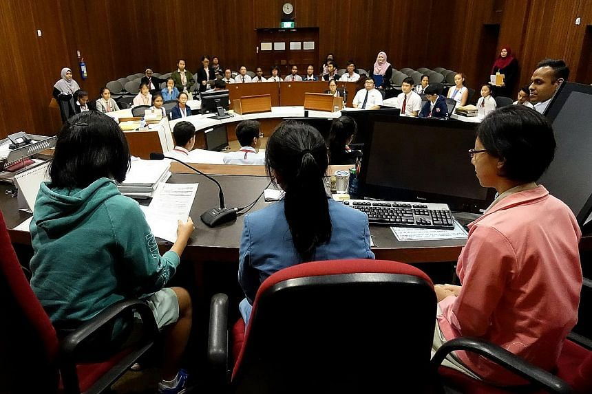 "Secondary school students role-playing in a mock trial as part of the ""A Day In Court"" seminar, organised by the State Courts of Singapore. The participants took up their roles with utmost gravity as they had to decide the offender's punishment, whil"