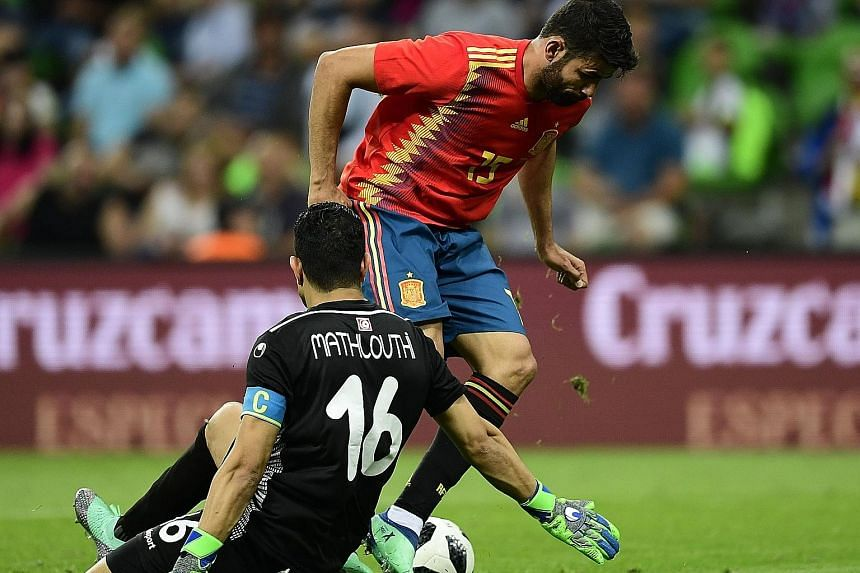 Spain's Diego Costa getting past Tunisia's goalkeeper Aymen Mathlouthi. The Atletico Madrid forward set up Iago Aspas' winner and was a nuisance for the Africans' defenders on Saturday.