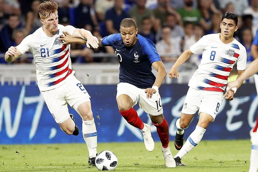 France's Kylian Mbappe beating US players Tim Parker (left) and Joe Corona during their friendly on Saturday. The French striker scored the equaliser in the 1-1 draw.