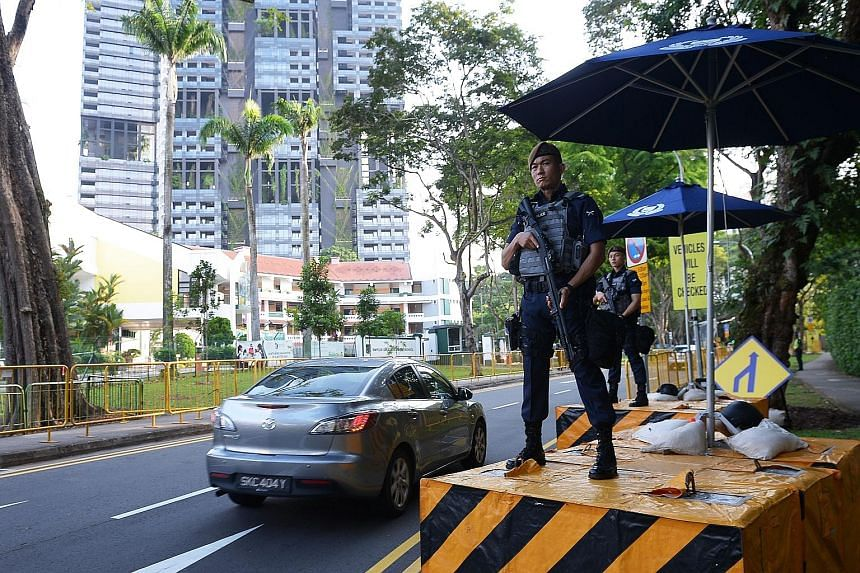 Armed police officers standing guard on Sunday outside the Shangri-La Hotel, where US President Donald Trump is expected to stay during his visit to Singapore for the United States-North Korea summit on June 12.