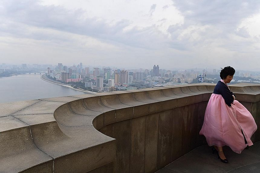 An official tour guide fighting strong winds at the top of Juche Tower in Pyongyang. If North Korea and the US do manage to find common ground, this could gradually open up rich new possibilities for Pyongyang.