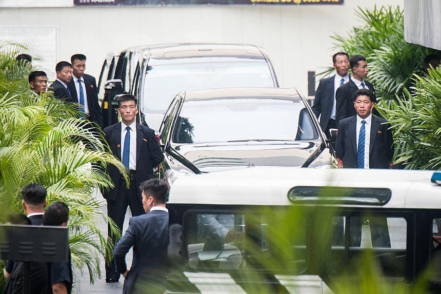 Onlookers lining Orchard Road to catch a glimpse of North Korean leader Kim Jong Un's vehicle convoy as it travelled past Ion Orchard mall on its way to the Istana, where he met Prime Minister Lee Hsien Loong yesterday.