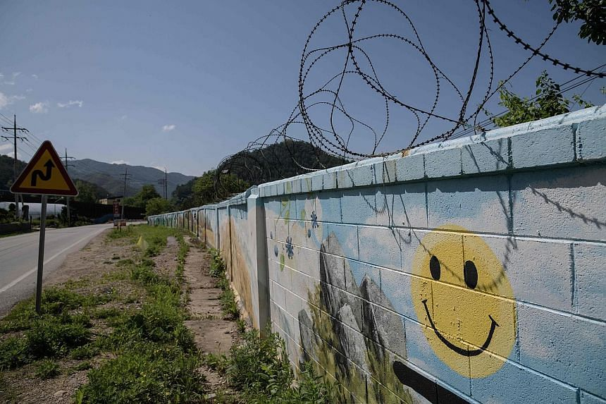 The wall of a military camp close to Haean-myeon, near the Demilitarised Zone separating North and South Korea. If a peace treaty is reached to end the Korean War, the forces ranged along the DMZ could gradually be scaled back and that might eventual