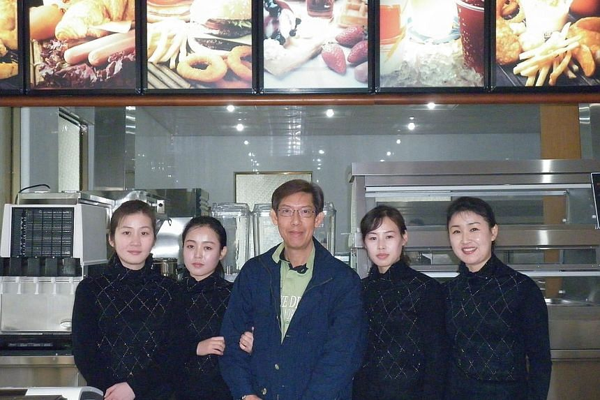 """Businessman Patrick Soh, who trained staff and taught them how to make hamburgers for the Samtaesong eatery, said the training went smoothly as the North Koreans were """"very polite and disciplined""""."""