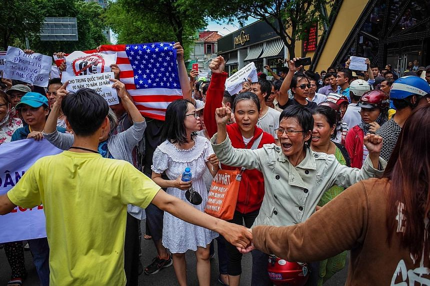 Vietnamese protesting in Ho Chi Minh City yesterday against a draft law that will grant firms land leases for up to 99 years in special zones, which some fear will be dominated by China.