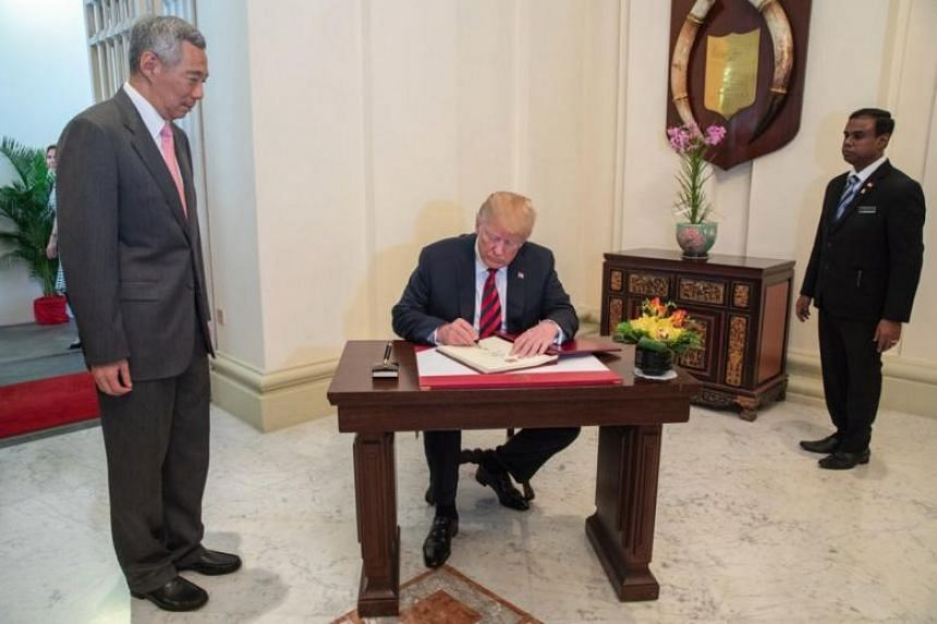 Prime Minister Lee Hsien Loong with US President Donald Trump at the Istana, on June 11, 2018.