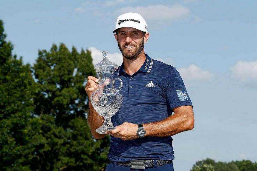 Dustin Johnson poses with the trophy after the final round of the FedEx St Jude Classic at TPC Southwind, on June 10, 2018 in Memphis, Tennessee.
