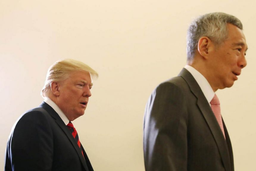US President Donald Trump and Singapore's Prime Minister Lee Hsien Loong walking together during a meeting at the Istana.