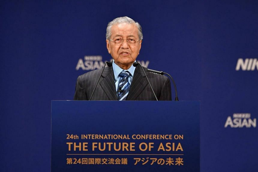 Prime Minister Mahathir Mohamad's proposal of a new national car company at the 24th Nikkei Conference on the Future of Asia was met with a mixed reception.