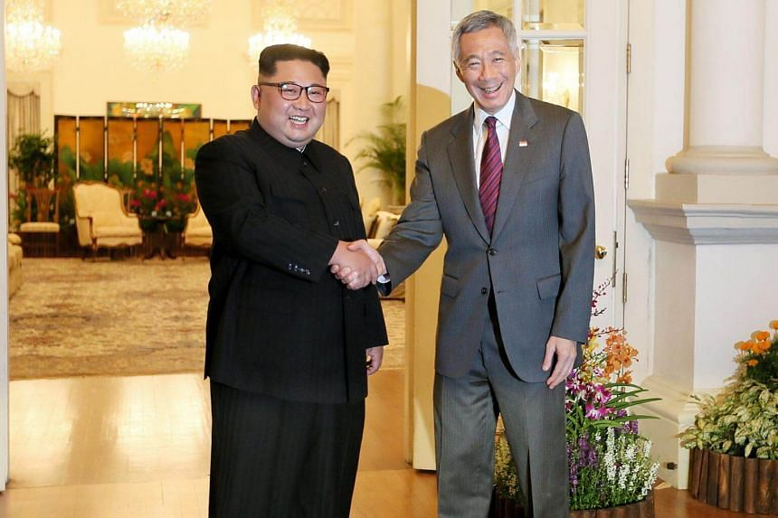 North Korea Leader Kim Jong Un meeting Singapore Prime Minister Lee Hsien Loong at the Istana after his arrival.
