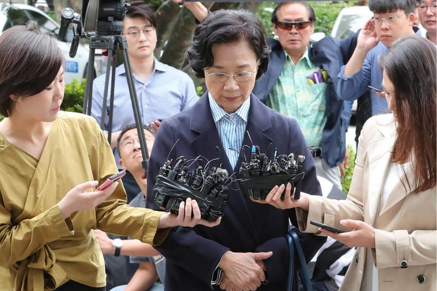 Lee Myung Hee, the wife of Korean Air chairman Cho Yang Ho, is surrounded by reporters as she arrives at an immigration office in Seoul, on June 11, 2018.