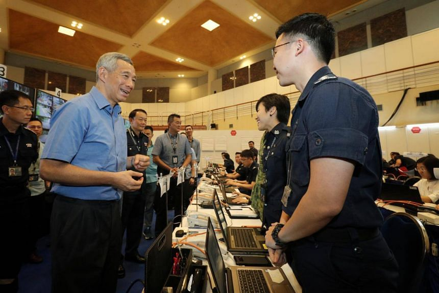Prime Minister Lee Hsien Loong speaking to officers on duty during his visit to the Home Team command post in Novena, on June 10, 2018.