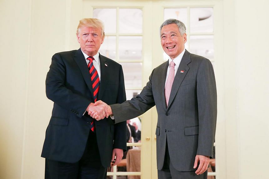 US President Donald Trump meeting with Singapore PM Lee Hsien Loong at the Istana on June 11, 2018.