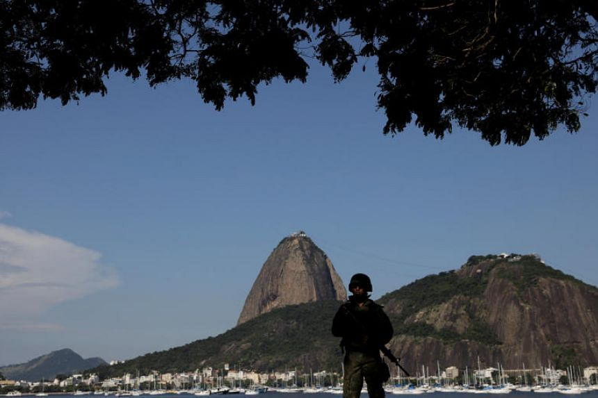 Brazilian Marines patrol the Botafogo neighbourhood with Sugarloaf Mountain in the background in Rio de Janeiro, Brazil, on April 3, 2018.