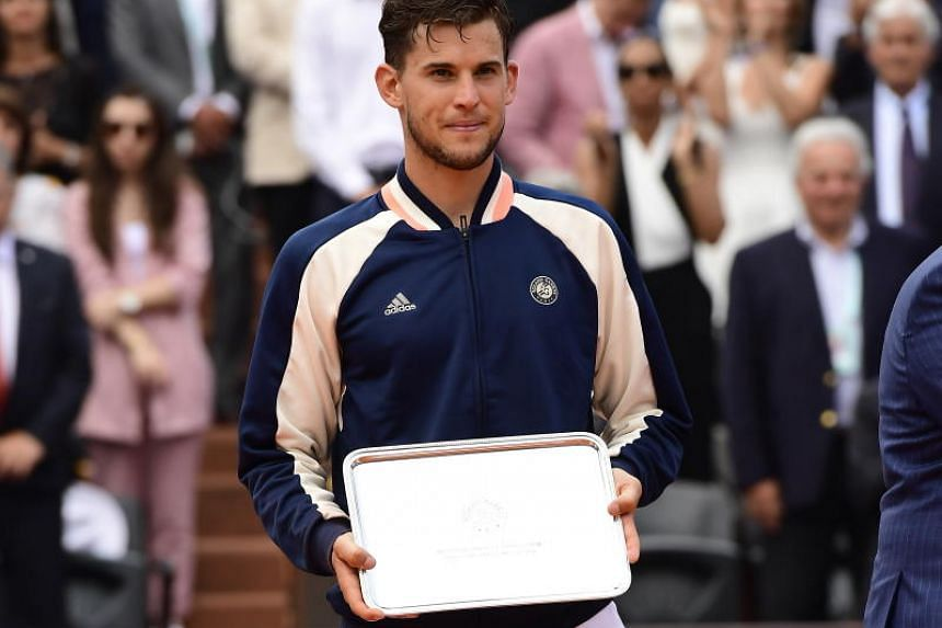 Dominic Thiem of Austria reacts with his runner-up trophy after losing against Rafael Nadal of Spain (not pictured) during their men's final match during the French Open tennis tournament at Roland Garros in Paris, France, on June 10, 2018.